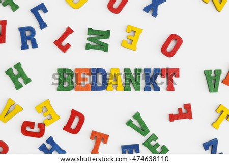"Series ""Thank you"": word thank you in Dutch ""Bedankt"" in wooden letters on white background"