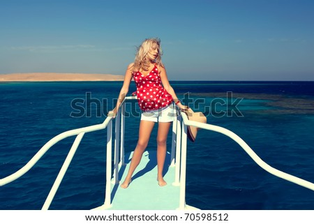 Series The beautiful girl costs aft yachts - stock photo