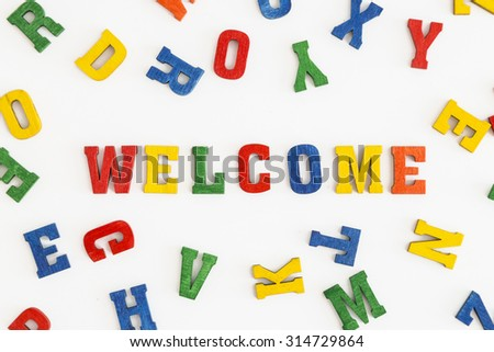 "Series ""Welcome"": word Welcome in wooden letters on white background"