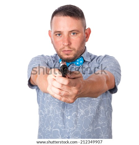 Serious adult man with a beard in a blue bow tie in summer shirt with a firearm in hand in hand aiming at you on an isolated white background