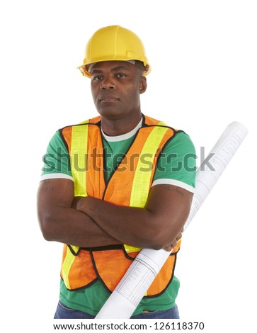 serious african american construction worker with arms crossed holding blueprints.