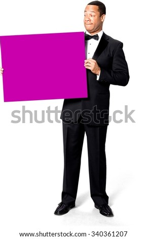 Serious African man with short black hair in evening outfit holding large sign - Isolated