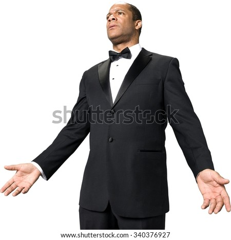 Serious African man with short black hair in evening outfit with arms open - Isolated
