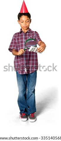 Serious African young boy with short black hair in casual outfit using money - Isolated