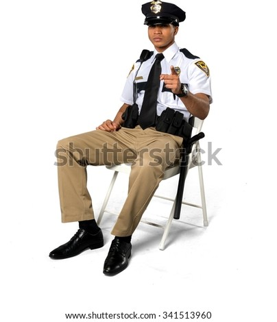 Serious African young man with short black hair in uniform pointing using finger - Isolated - stock photo