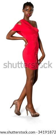 Serious African young woman with short black hair in evening outfit with hands on thighs - Isolated