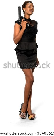 Serious African young woman with short dark brown hair in evening outfit holding handgun - Isolated - stock photo