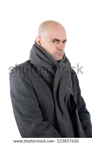 Serious and angry bald man wearing  tweed coat and scarf. Looking at camera. Isolated. - stock photo
