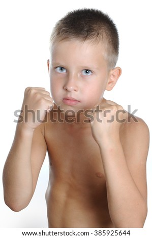 Serious and determined young boy wearing boxing gloves and looking at the camera. Isolated on white - stock photo