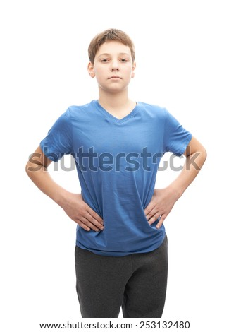 Serious and focused young boy in a blue t-shirt, portrait isolated over the white background - stock photo