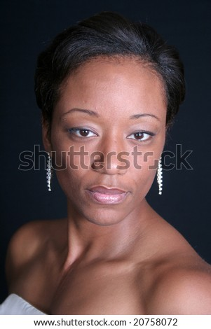 serious and thoughtful africna american woman with eye contact - stock photo