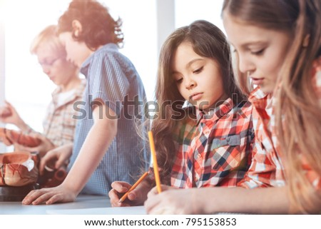 Serious approach ambitious adorable lovely kids stock photo serious approach ambitious adorable lovely kids studying human anatomy and working on a group project ccuart Image collections