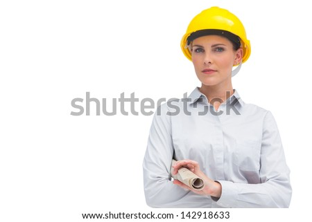 Serious architect holding rolled up plan on white background