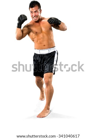Serious Asian man with short black hair in athletic costume hitting - Isolated