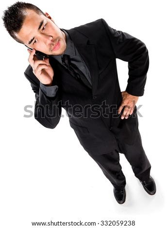 Serious Asian man with short black hair in business formal outfit using mobile phone - Isolated