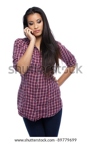 serious asian woman in studio - stock photo