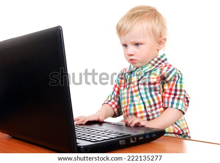 Serious Baby Boy with Laptop Isolated on the White Background