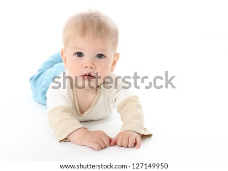 Serious baby on white background, isolated, tummy time - stock photo