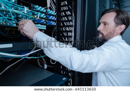 Serious bearded man looking at the internet wires