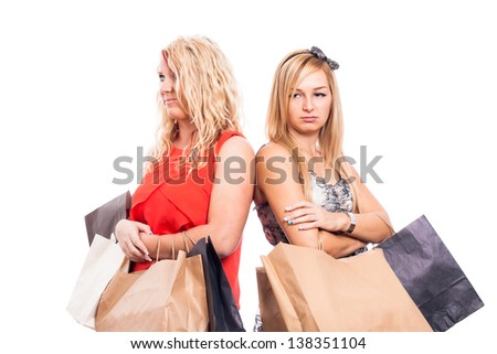 Serious blond girls with shopping bags, isolated on white background - stock photo