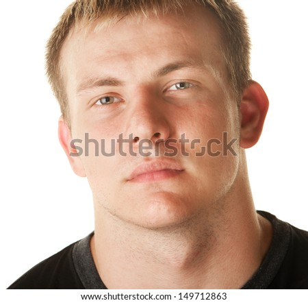 Serious blond muscular European man over white background