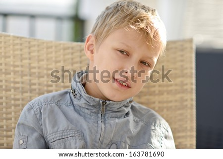 serious boy looking at  left - stock photo
