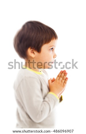 Serious boy praying to God, prayer child
