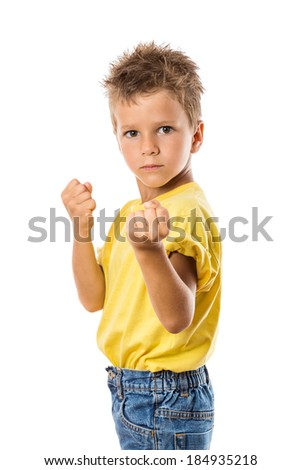 Serious boy showing his fists, isolated on white - stock photo