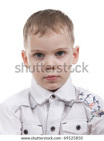 Serious boy standing on white background