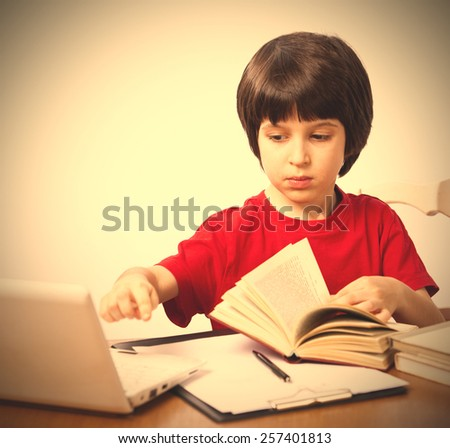 serious boy with a book and a netbook. instagram image style