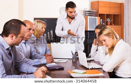 Serious business people during conference call indoors - stock photo