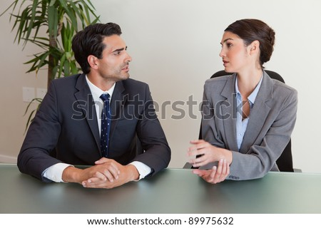 Serious business people negotiating in a meeting room - stock photo