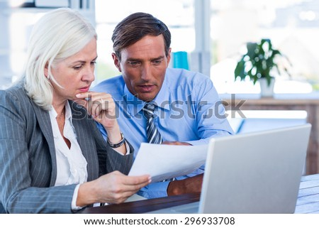 Serious business people working together in office - stock photo