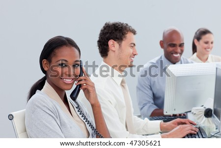 Serious business team at work in the office - stock photo