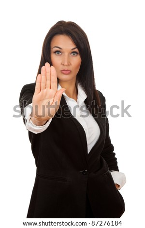 Serious business woman making stop hand sign isolated over white background
