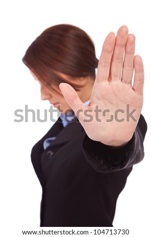 Serious business woman making stop sign over white, focus on hand - stock photo
