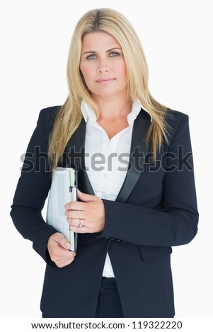 Serious business woman posing with a clipboard in the white background - stock photo