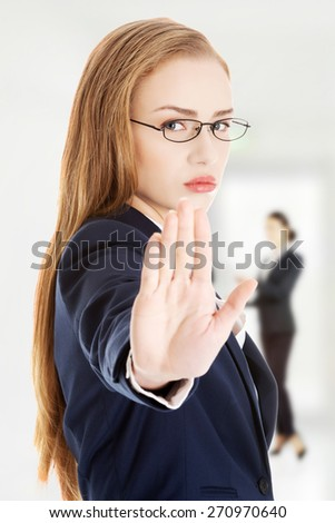 Serious business woman showing stop with hand. - stock photo