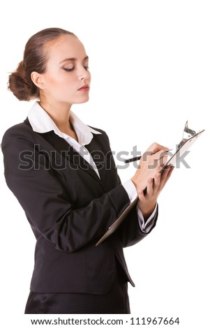 Serious business woman with a clipboard makes notes in document. Isolated on white background. - stock photo