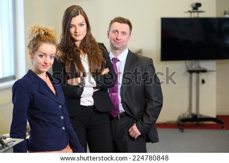 Serious business woman with colleagues in the office - stock photo