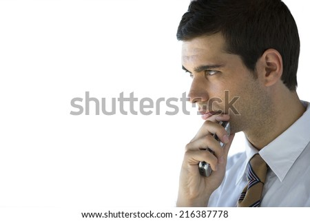 Serious businessman holding cell phone, cut out