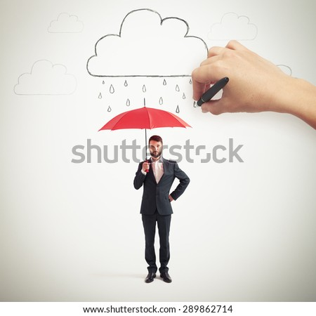 serious businessman in formal wear holding red umbrella under drawing clouds with rain - stock photo