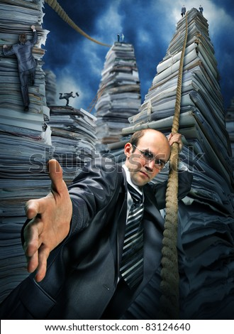 Serious businessman inviting you to climbing up the pile of paperwork - stock photo