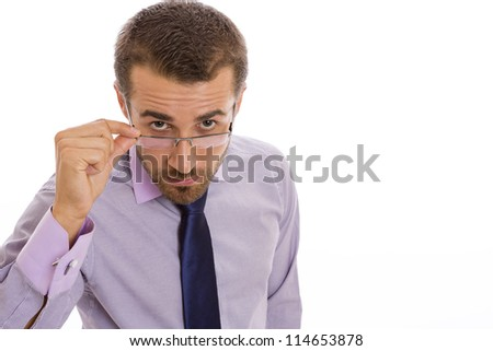 Serious businessman looking to the camera over eyeglasses on white background. - stock photo