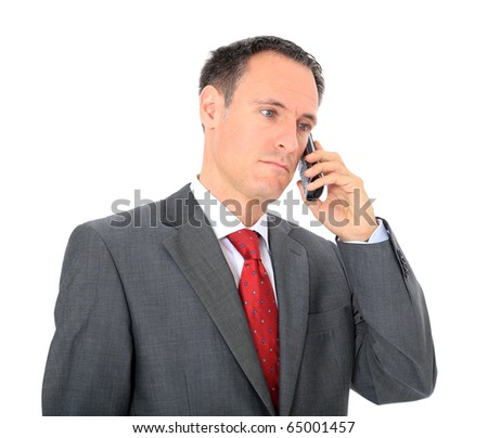 Serious businessman making a phone call. All on white background.