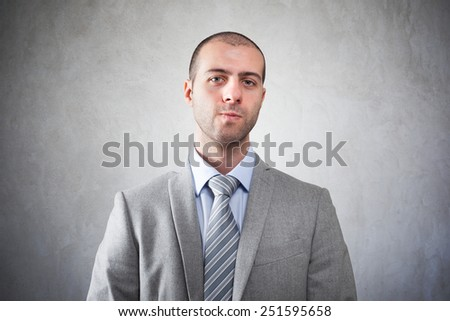 Serious businessman on a grungy background - stock photo