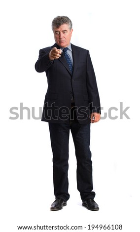 Serious businessman pointing
