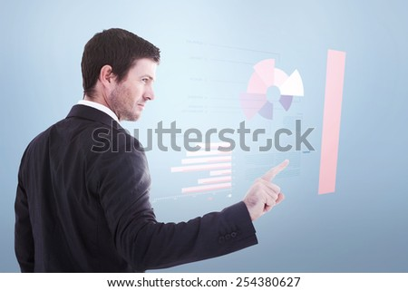 Serious businessman standing and pointing the finger against grey vignette