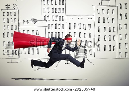 serious businessman wearing like superhero very fast running in drawing street - stock photo