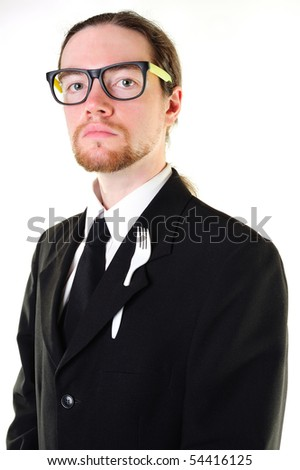 Serious businessman with a fork in the buttonhole
